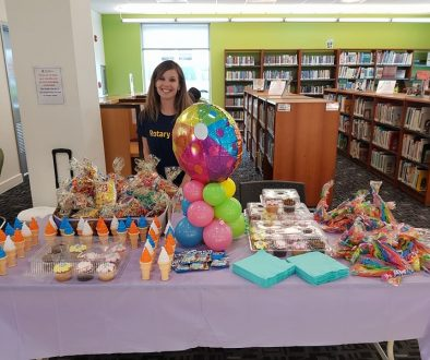 Rotarian Katherine Dilbert, former Director of Vocational Service, at the  Reading Program at the Public Library's for Children in all Districts - with refreshments.