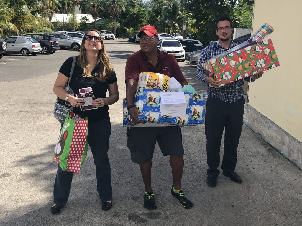 Rotarians delivering toys and supplies to NAU